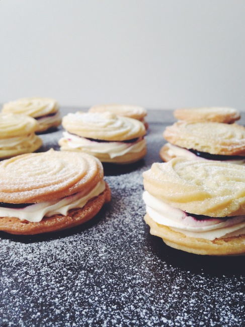 side view of viennese whirls with jam and cream