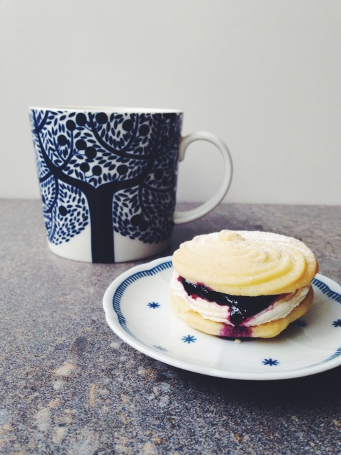 mug with tree print next to biscuit on plate