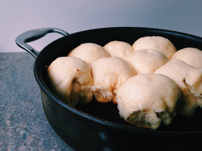 side view of buns in a pan