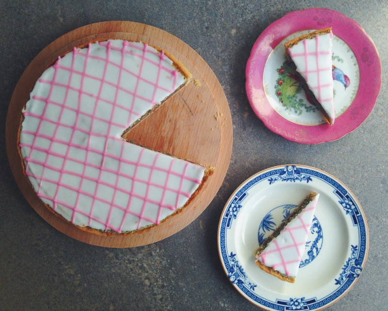 Top view of tart with slices out of it and two plate with slice on each