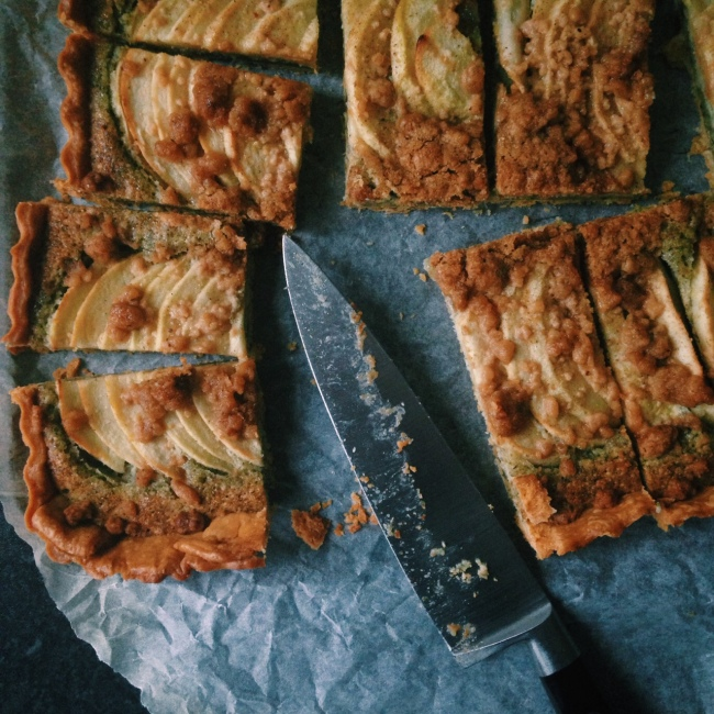 Apple Crumble Nut-Free Frangipane Tart in slices with knife