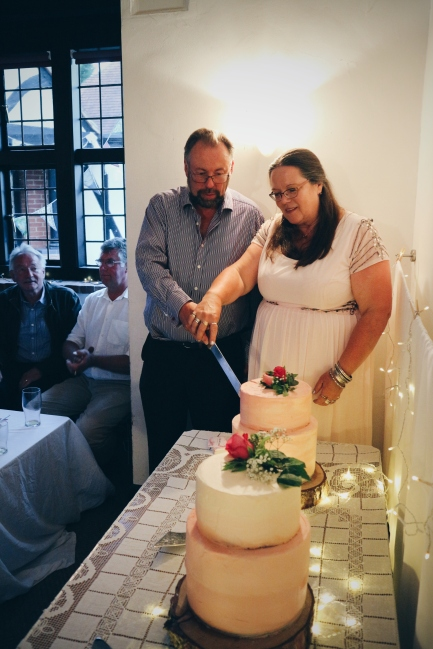 DIY Wedding Cake: The bride and groom cutting the cake